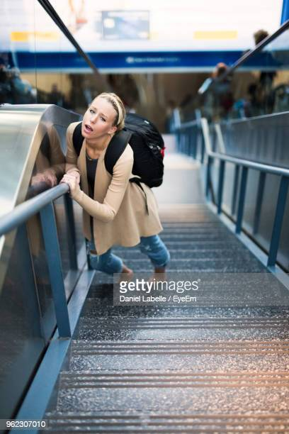 Portrait Of Woman Standing On Steps
