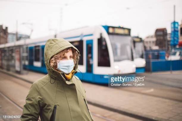 portrait of woman standing on street in city - bortes stock pictures, royalty-free photos & images