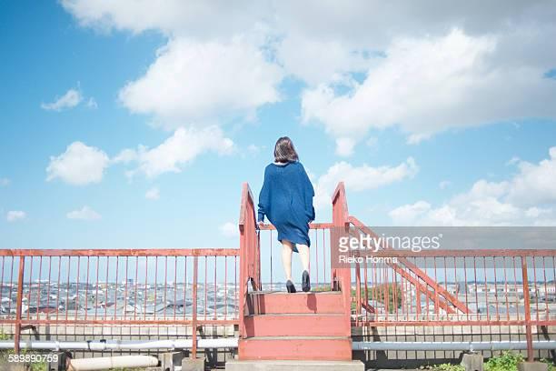 Portrait of woman standing roof top