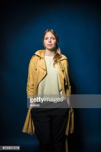 Portrait Of Woman Standing With Hands In Pockets