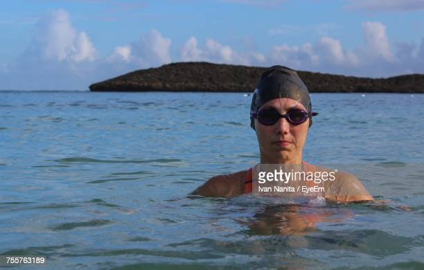 Portrait Of Woman Swimming In Sea Against Sky