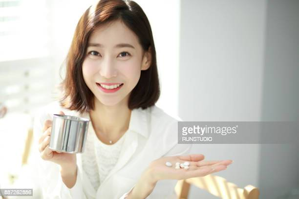 Portrait of woman taking medicine
