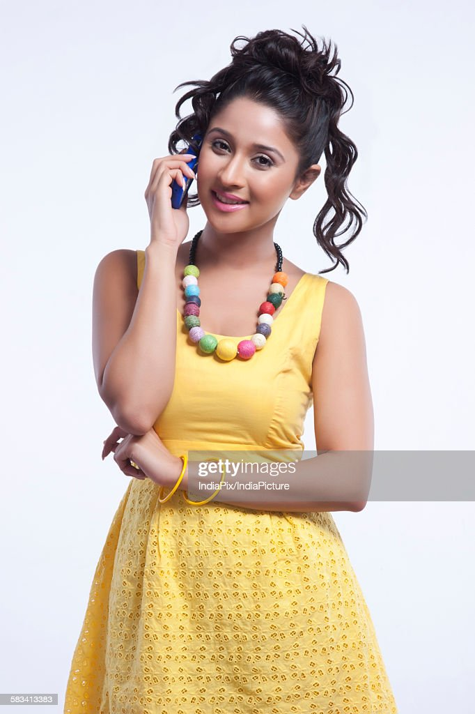 Portrait of woman talking on mobile phone : Stock Photo