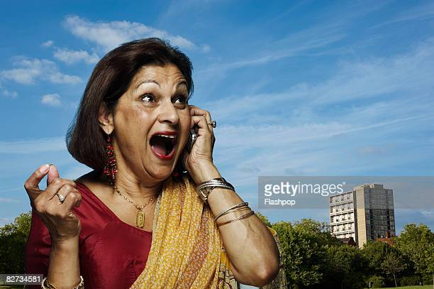 Portrait of woman talking on mobile phone