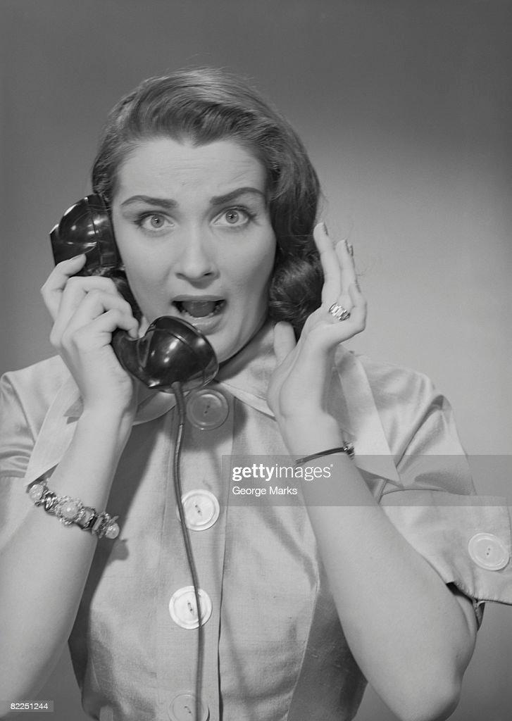 Portrait of woman talking on phone : Stock Photo