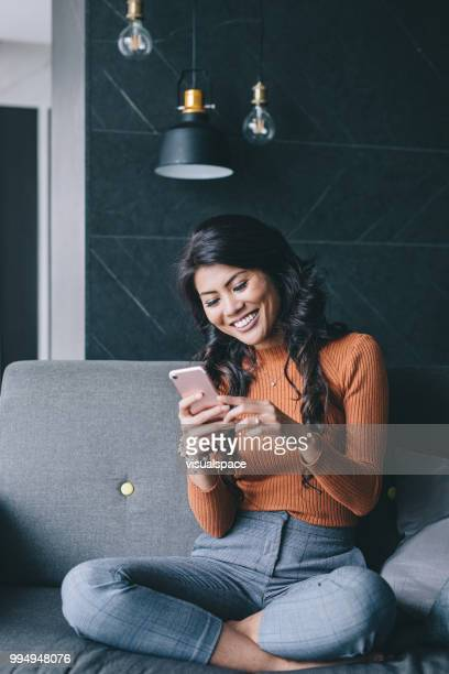 portrait of woman using her smartphone. - fashionable stock pictures, royalty-free photos & images