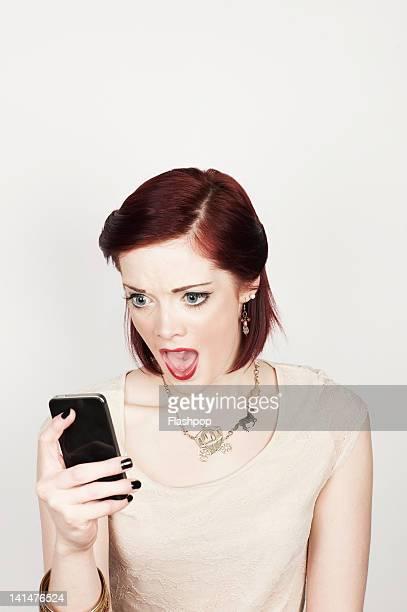 Portrait of woman using phone