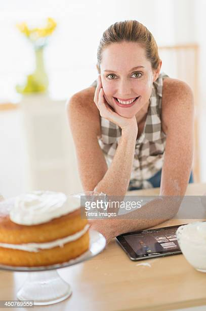 Portrait of woman using tablet pc in kitchen