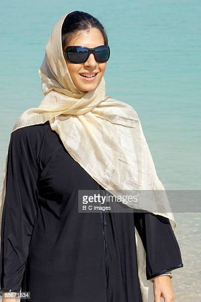 Portrait of woman walking at the beach, Dubai, UAE