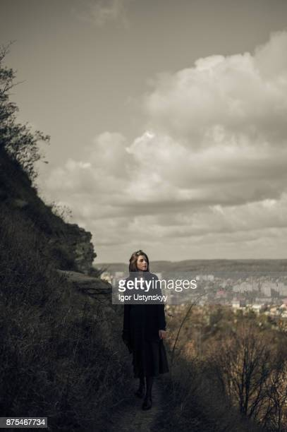 Portrait of woman walking in autumn park