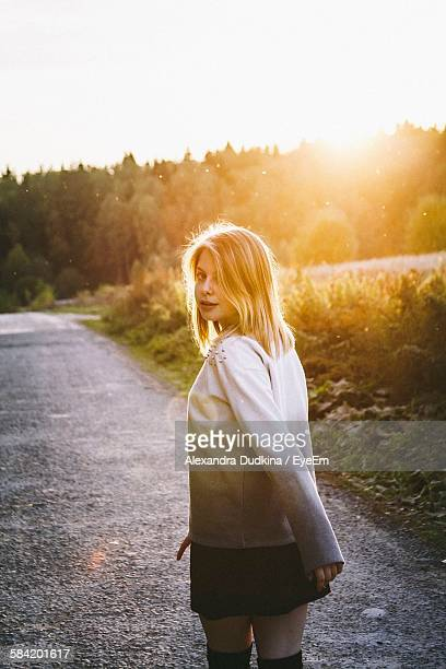 Portrait Of Woman Walking On Road Against Clear Sky At Morning