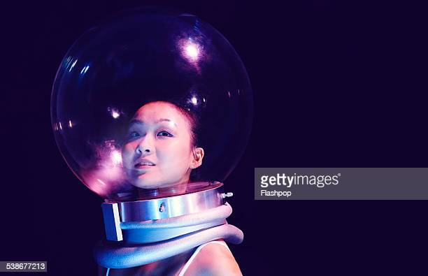 Portrait of woman wearing a space helmet