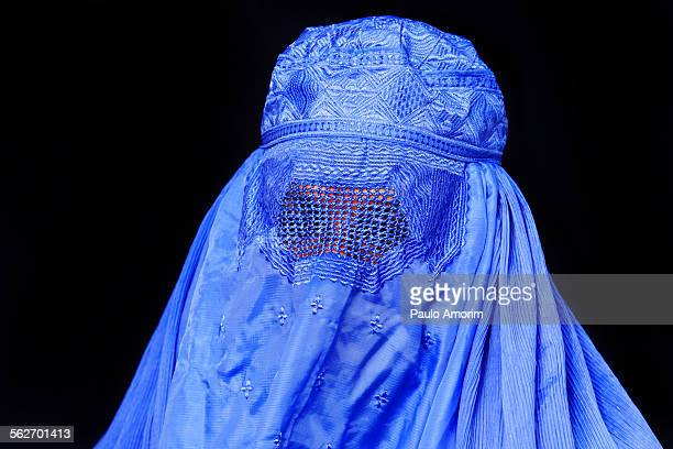 Portrait of woman wearing afghan burka