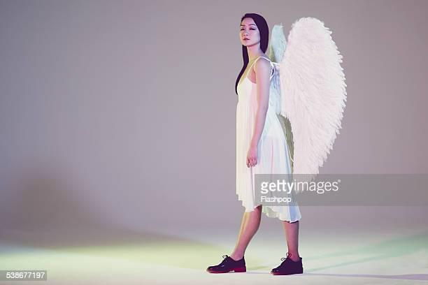 Portrait of woman wearing angel wings