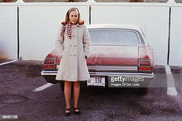 portrait of woman wearing coat by car - coat stock pictures, royalty-free photos & images