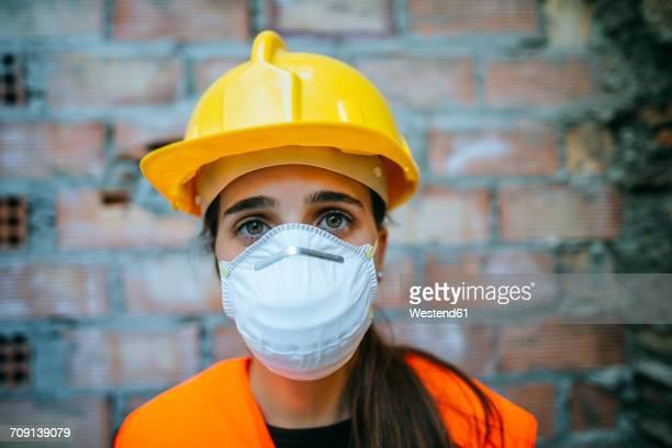 Portrait of woman wearing dust mask