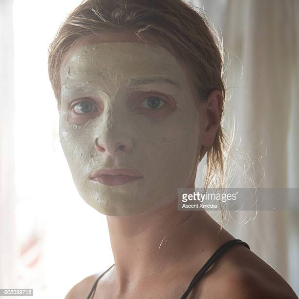 Portrait of woman wearing face mask, indoors