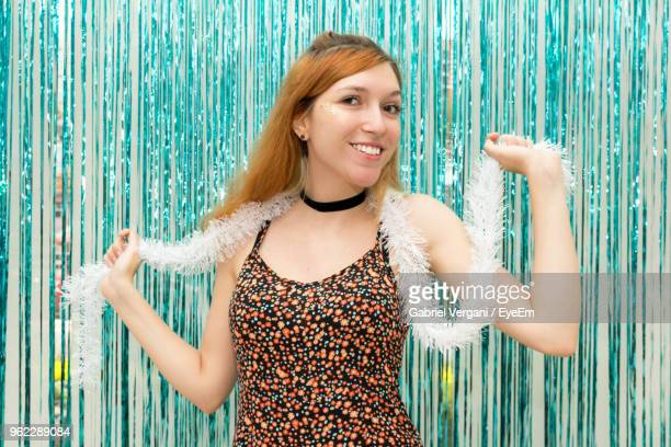 Portrait Of Woman Wearing Feather Boa By Decoration