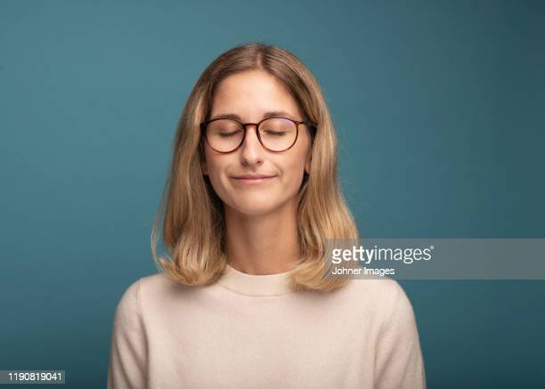 portrait of woman wearing glasses - eyes closed stock pictures, royalty-free photos & images