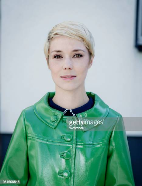 portrait of woman wearing green vintage leather jacket - green coat stock pictures, royalty-free photos & images