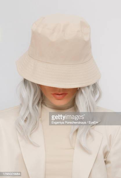 portrait of woman wearing hat against white background - チューリップ帽 ストックフォトと画像