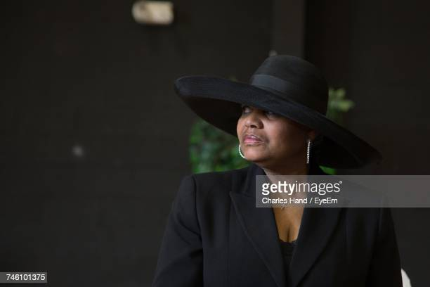 portrait of woman wearing hat - funeral stock pictures, royalty-free photos & images