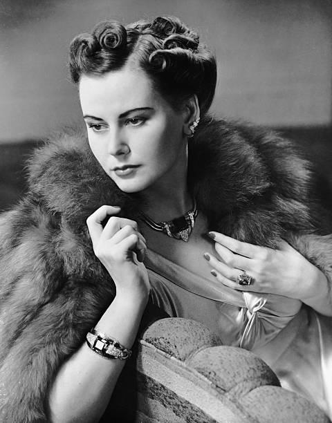 Portrait of woman wearing jewelry & fur coat