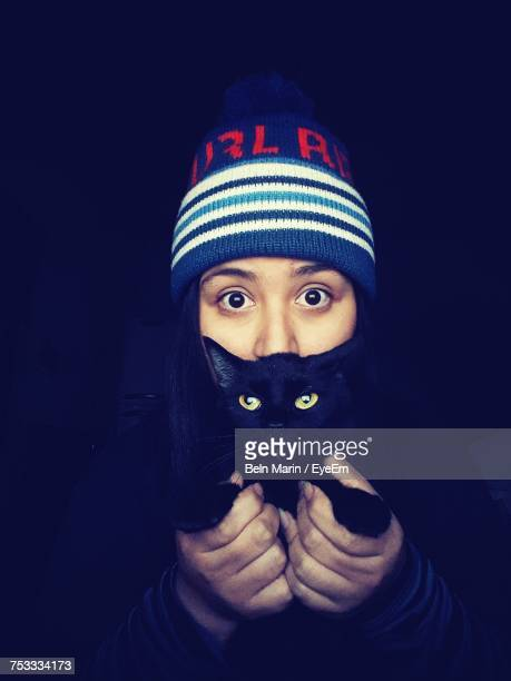 Portrait Of Woman Wearing Knit Hat With Cat