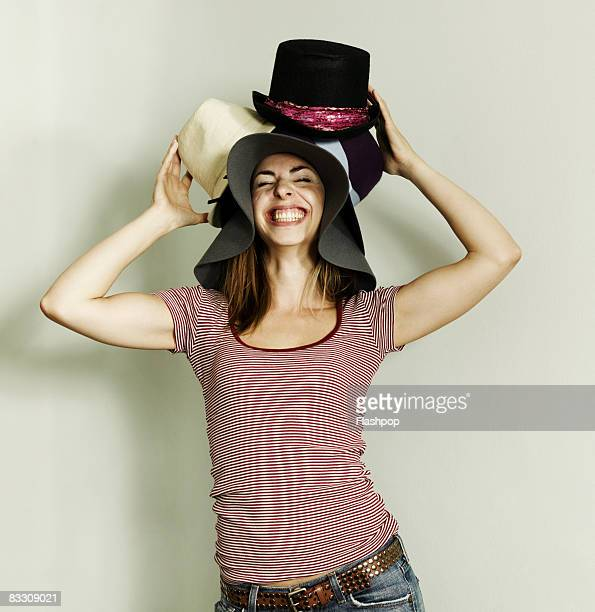Portrait of woman wearing lots of hats