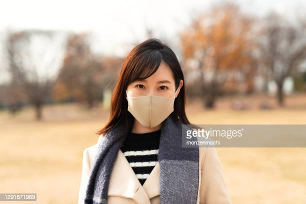 portrait of woman wearing mask - saitama prefecture stock pictures, royalty-free photos & images