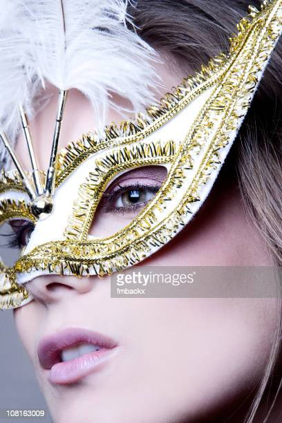 Portrait of Woman Wearing Ornate Mask