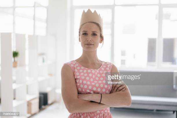 Portrait of woman wearing paper crown