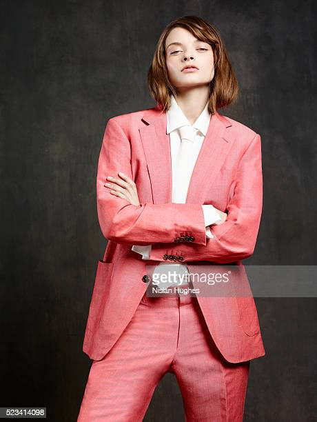 Portrait of woman wearing pink suit