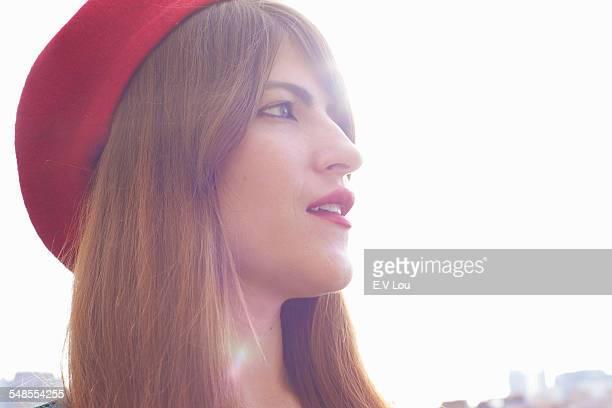 portrait of woman wearing red hat - ベレー帽 ストックフォトと画像