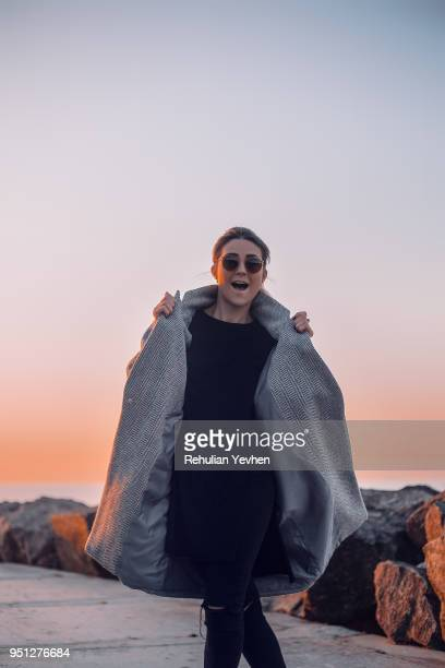 portrait of woman wearing sunglasses and winter coat posing for camera, odessa, odeska oblast, ukraine, eastern europe - exhibitionniste photos et images de collection