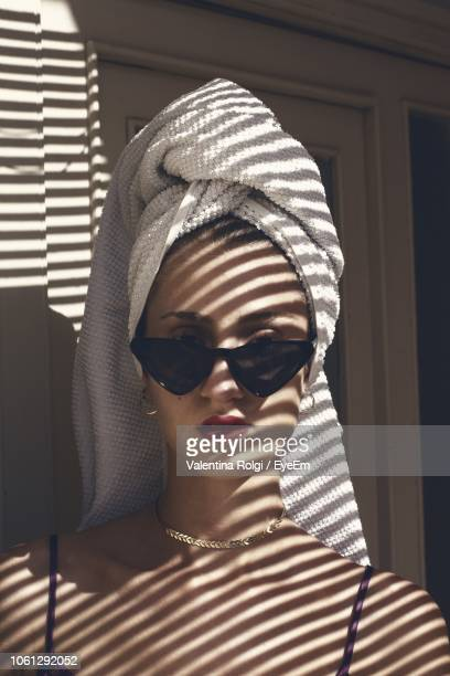 Portrait Of Woman Wearing Sunglasses At Home