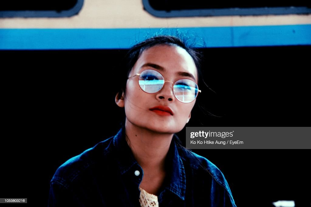Portrait Of Woman Wearing Sunglasses : Stock Photo