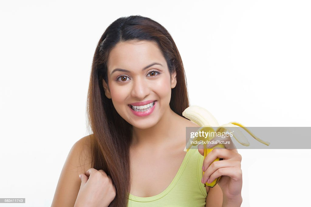 Portrait of woman with a banana : Stock Photo