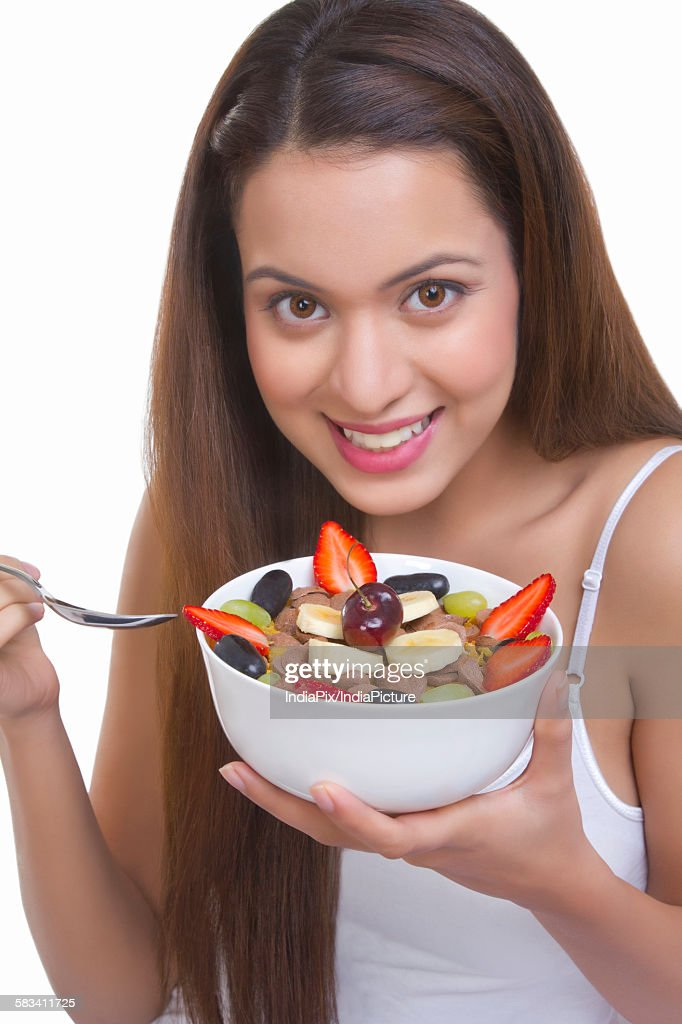 Portrait of woman with a bowl of cereal : Stock Photo