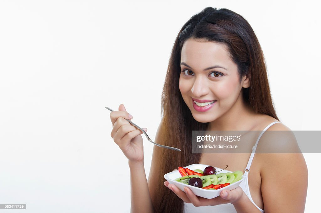 Portrait of woman with a bowl of fruits : Stock Photo