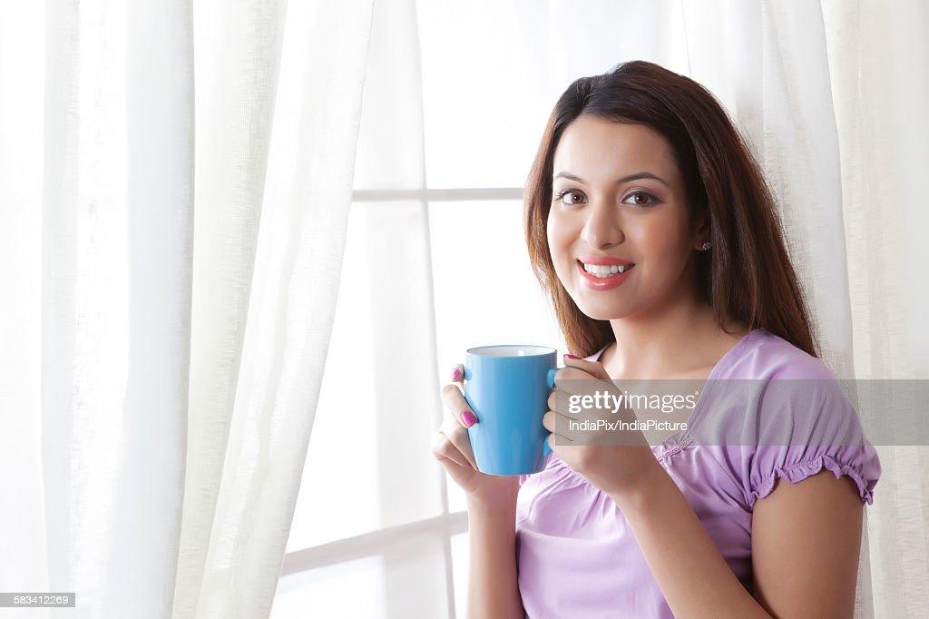 Portrait of woman with a mug of tea : Stock Photo