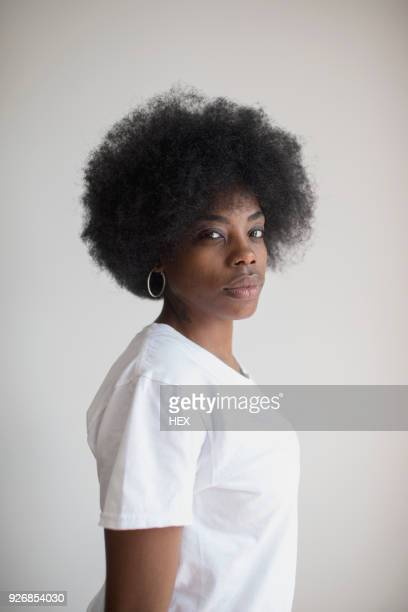 portrait of woman with an afro - hoop earring stock pictures, royalty-free photos & images