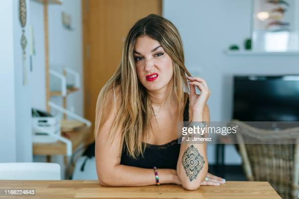 portrait of woman with angry face in home's living room - disgust stock pictures, royalty-free photos & images