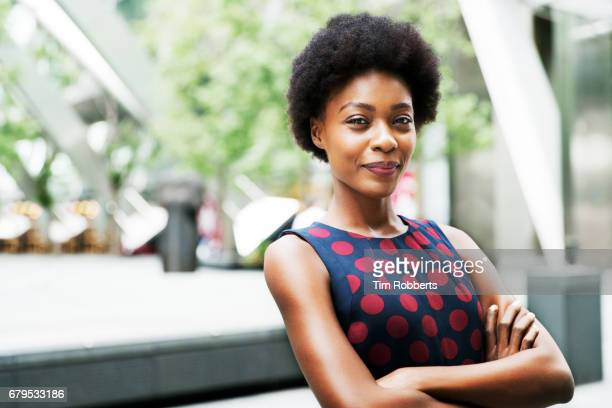 portrait of woman with arms crossed - attitude stock pictures, royalty-free photos & images