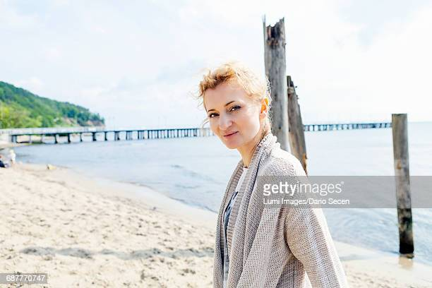 Portrait of woman with blond hair on beach