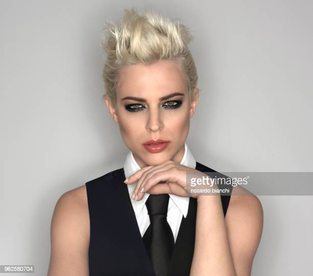 portrait of woman with blonde short hair shirt and tie - white tuxedo stock pictures, royalty-free photos & images