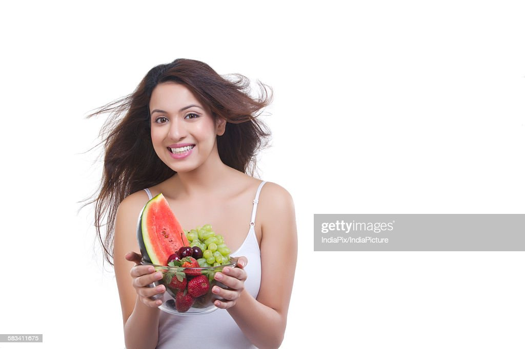 Portrait of woman with bowl of fruits : Stock Photo