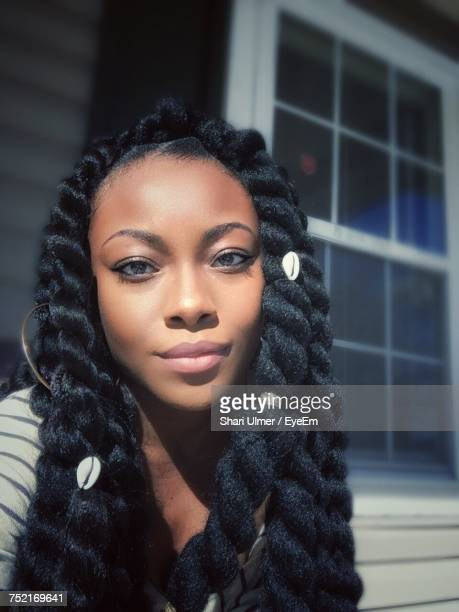 portrait of woman with braided hair - braided hair stock pictures, royalty-free photos & images