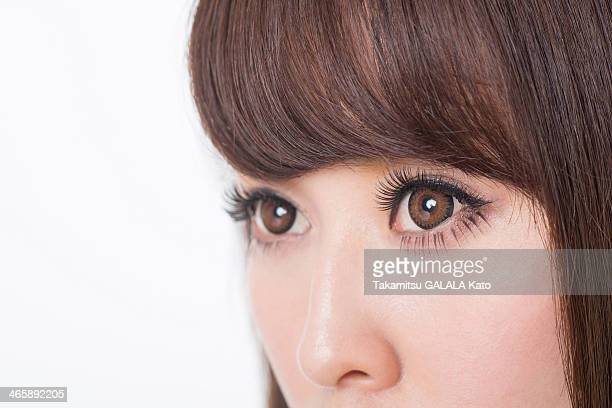 portrait of woman with brown eyes, close up - アイライナー ストックフォトと画像
