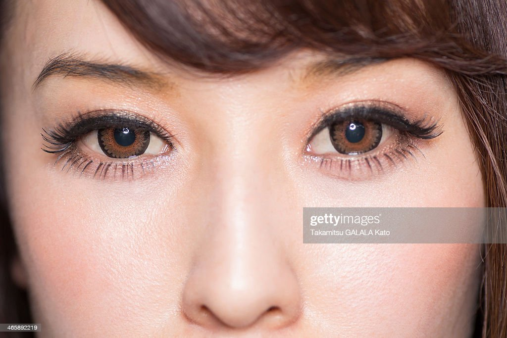 Portrait of woman with brown eyes close up : Stock Photo
